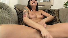 Solo tattooed beauty caresses her sexy body and plays with her slit